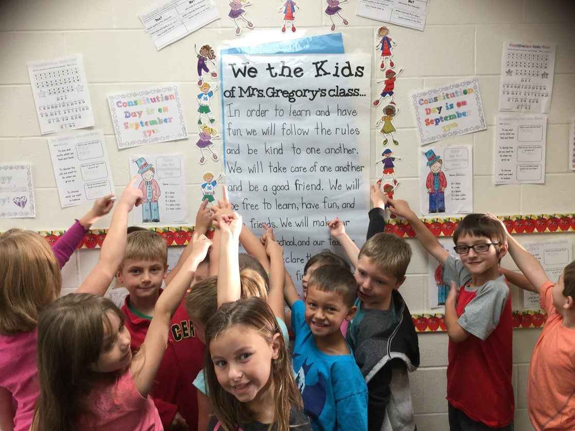 Mrs. Gregory's 1st Grade class creates a classroom constitution.